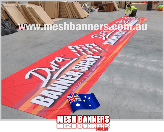 Man checking banner sign tolerance and final quality
